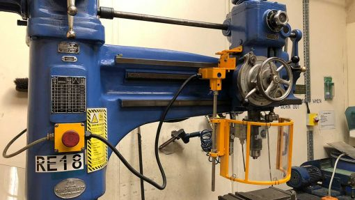 radial drill with an interlocked machine guard